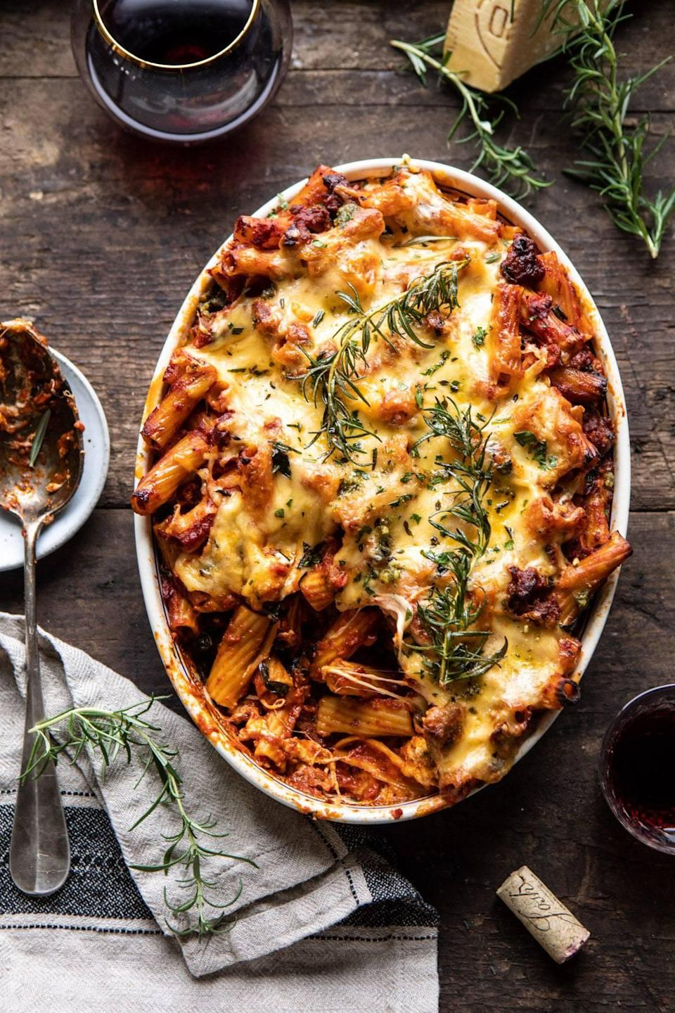 """<p>Step up your dinner when you cook up this drool-worthy rigatoni. Now this recipe is fit to feed eight people, and if you like pasta, we suggest making the full recipe even if it's just two of you because it's <em>that</em> good. With Italian chicken sausage, plenty of cheese, and a zesty pesto sauce, you'll want to nosh on this for days to come.</p> <p><strong>Get the recipe:</strong> <a href=""""https://www.halfbakedharvest.com/one-pot-spicy-pesto-cheese-baked-rigatoni/"""" class=""""link rapid-noclick-resp"""" rel=""""nofollow noopener"""" target=""""_blank"""" data-ylk=""""slk:one-pot spicy pesto cheese baked rigatoni"""">one-pot spicy pesto cheese baked rigatoni</a></p>"""