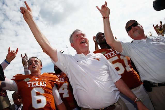 DALLAS, TX - OCTOBER 12: Case McCoy #6 of the Texas Longhorns and head coach Mack Brown of the Texas Longhorns celebrate after the Longhorns beat the Oklahoma Sooners 36-20 at the Cotton Bowl on October 12, 2013 in Dallas, Texas. (Photo by Tom Pennington/Getty Images)