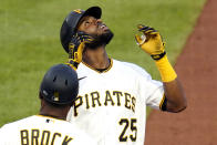 Pittsburgh Pirates' Gregory Polanco (25) celebrates as he stands on first base after driving in a run with a single off Philadelphia Phillies starting pitcher Vince Velasquez during the second inning of a baseball game in Pittsburgh, Friday, July 30, 2021. (AP Photo/Gene J. Puskar)