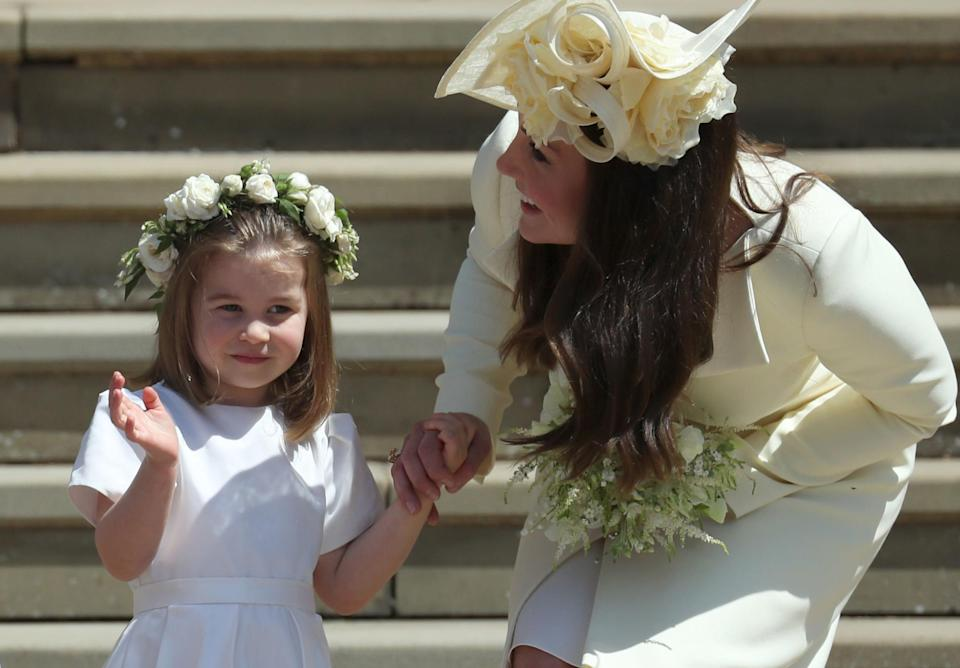 Kate Middleton is said to have broken down in tears when she saw Princess Charlotte in her bridesmaid dress at the dress rehearsal of Meghan and Harry's big day. Source: Getty