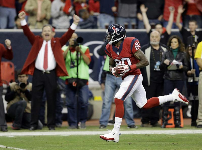 Houston Texans' Andre Johnson runs for a touchdown after making a reception during the first quarter of an NFL football game against the Indianapolis Colts, Sunday, Nov. 3, 2013, in Houston. (AP Photo/David J. Phillip)