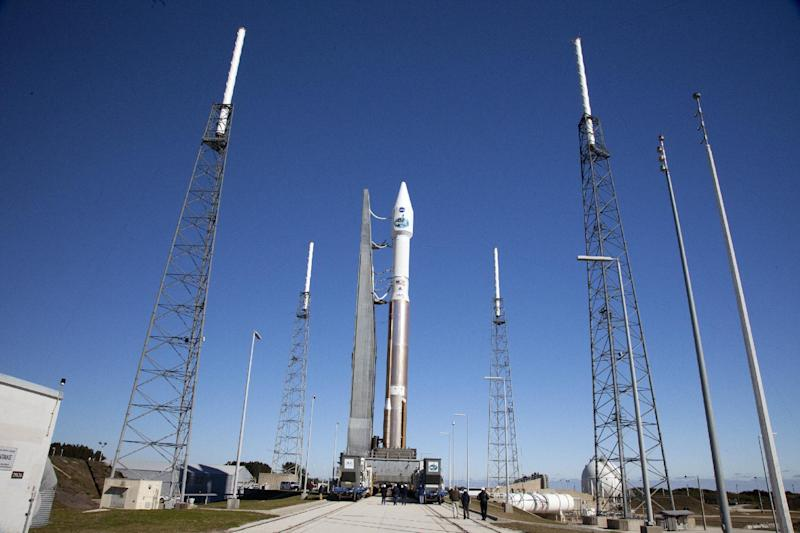 In a photo provided by NASA a United Launch Alliance Atlas V with TDRS-L atop, arrives at the launch pad at Cape Canaveral, Fla., Air Force Station's Launch Complex 41. The unmanned rocket is set to blast off Thursday night, Jan. 23, 2014, with the latest, third-generation Tracking and Data Relay Satellite. (AP Photo/Daniel Casper )