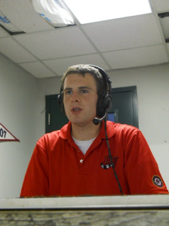 """<b class=""""credit"""">Photo by Brianna Healy</b>Nick announcing a minor league hockey game and fulfilling his dream!"""