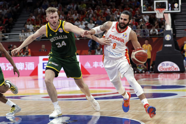 Ricky Rubio of Spain, right, drives past Jock Landale of Australia during their semifinal match in the FIBA Basketball World Cup at the Cadillac Arena in Beijing, Friday, Sept. 13, 2019. (AP Photo/Mark Schiefelbein)