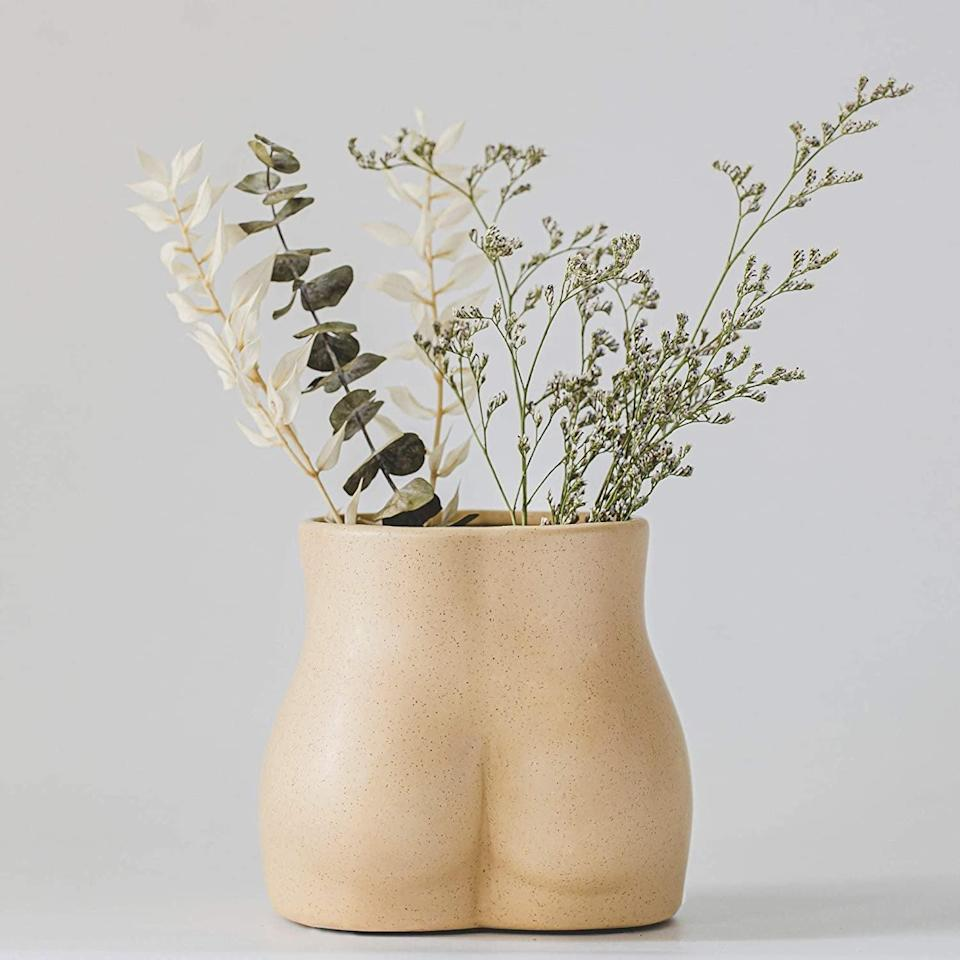 <p>Place this <span>Base Roots Butt Vase</span> ($18, originally $20) on your coffee table for a playful statement.</p>