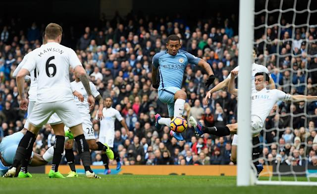 <p>Gabriel Jesus of Manchester City scores his sides first goal during the Premier League match between Manchester City and Swansea City at Etihad Stadium on February 5, 2017 in Manchester, England. </p>