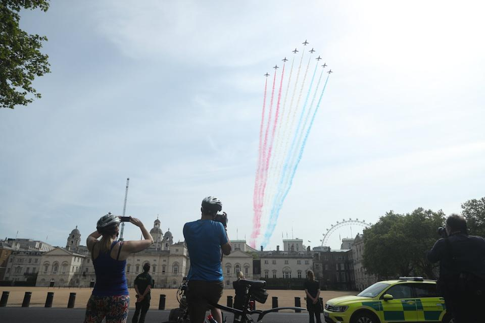 The Royal Air Force Red Arrows pass over the Horseguards Parade during a flypast in central London to mark the 75th anniversary of VE Day.