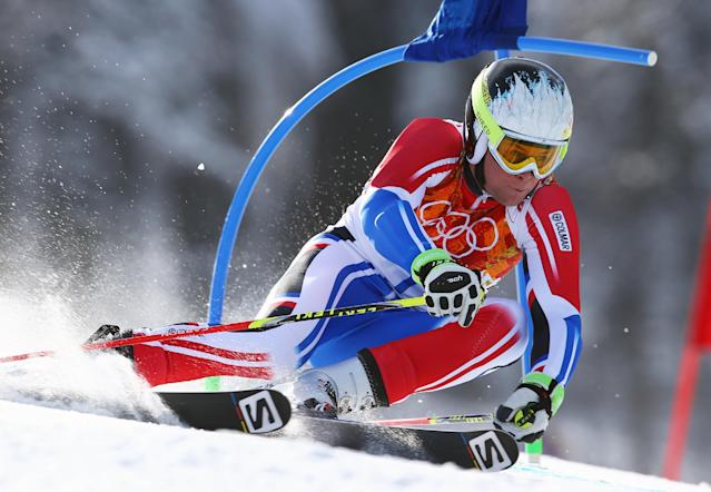 France's Alexis Pinturault makes a turn in the men's giant slalom to win the bronze medal at the Sochi 2014 Winter Olympics, Wednesday, Feb. 19, 2014, in Krasnaya Polyana, Russia. (AP Photo/Alessandro Trovati)