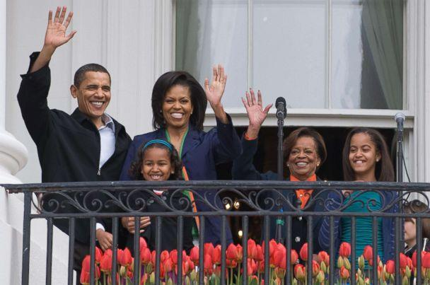 PHOTO: President Barack Obama waves alongside First Lady Michelle Obama, their daughters Sasha and Malia and Marian Robinson, Michelle's mother, during the annual White House Easter Egg Roll in Washington, April 13, 2009. (Saul Loeb/AFP/Getty Images)