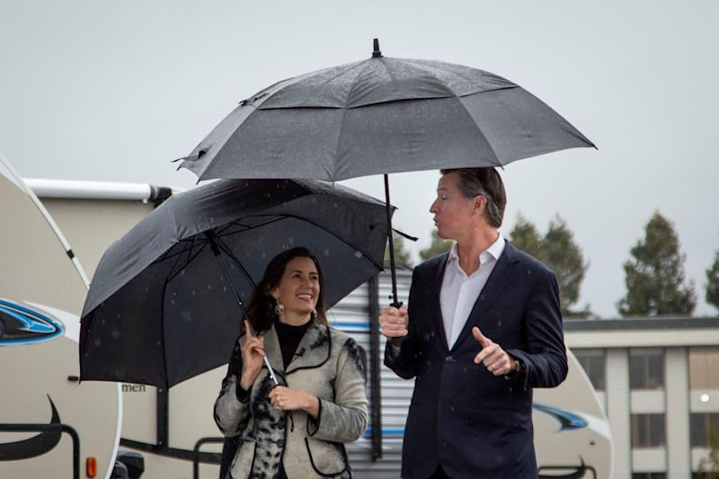 Oakland Mayor Libby Schaaf and California Gov. Gavin Newsom tour a new site where the state will provide emergency housing for the homeless in Oakland, Calif., on Thursday, Jan. 16, 2020.