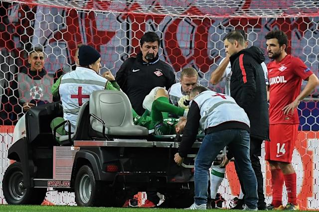Spartak Moscow's goalkeeper from Russia Artem Rebrov is transported off the field after being injured during the UEFA Champions League Group E football match against Liverpool September 26, 2017 (AFP Photo/Kirill KUDRYAVTSEV)