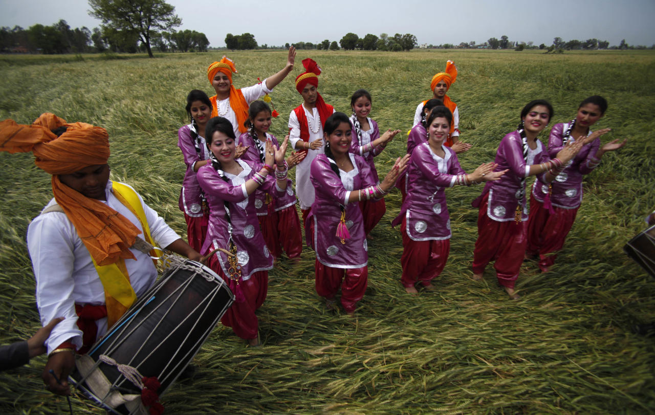 Indian dancers perform the 'Bhangra', a Punjabi folk dance, in a wheat field as they celebrate Baisakhi festival in Jammu, India, Friday, April 13, 2012. Baisakhi is the harvest festival widely celebrated in northern India, especially in the Punjab area. (AP Photo/Channi Anand)