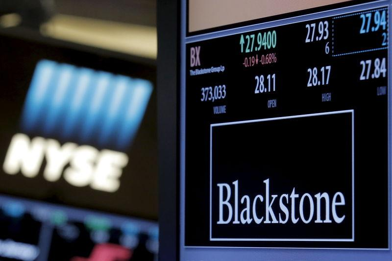 The ticker and trading information for Blackstone Group is displayed at the post where it is traded on the floor of the New York Stock Exchange