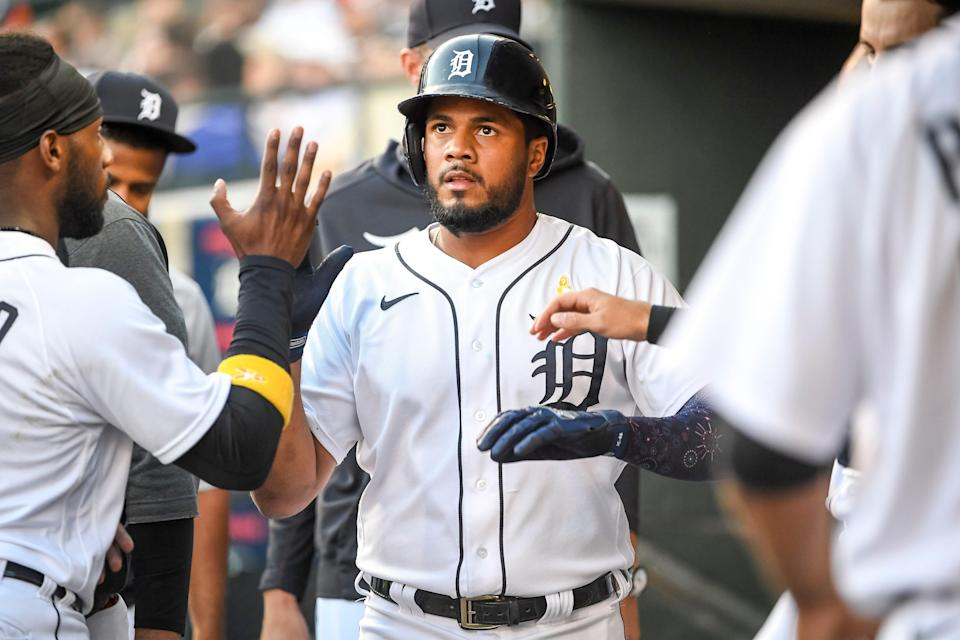 Jeimer Candelario #46 of the Detroit Tigers celebrates scoring a run against the Oakland Athletics during the bottom of the second inning at Comerica Park on September 01, 2021 in Detroit, Michigan.