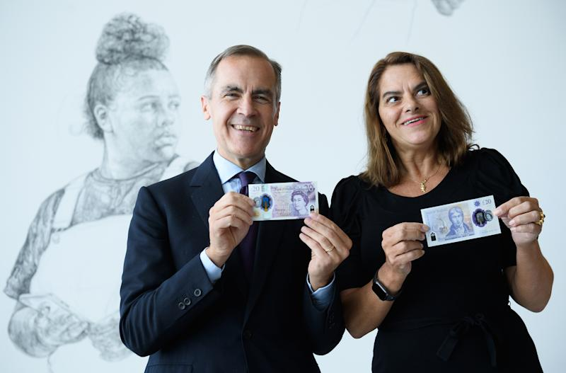 MARGATE, ENGLAND - OCTOBER 10: Mark Carney, Governor of the Bank of England and Artist, Tracey Emin unveil the new twenty pound note at the Turner Contemporary gallery on October 10, 2019 in Margate, England. The new twenty pound note will be made of polymer rather than paper, also the current portrait of scottish economist Adam Smith on the obverse, will be replaced with one of english artist J.M.W Turner. The new note will start to enter circulation in 2020 as the older note is gradually phased out. (Photo by Leon Neal/Getty Images)