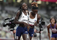 Christine Mboma, of Namibia, celebrates with Beatrice Masilingi, of Namibia after winning the silver medal in the final of the women's 200-meter at the 2020 Summer Olympics, Tuesday, Aug. 3, 2021, in Tokyo, Japan. (AP Photo/Martin Meissner)