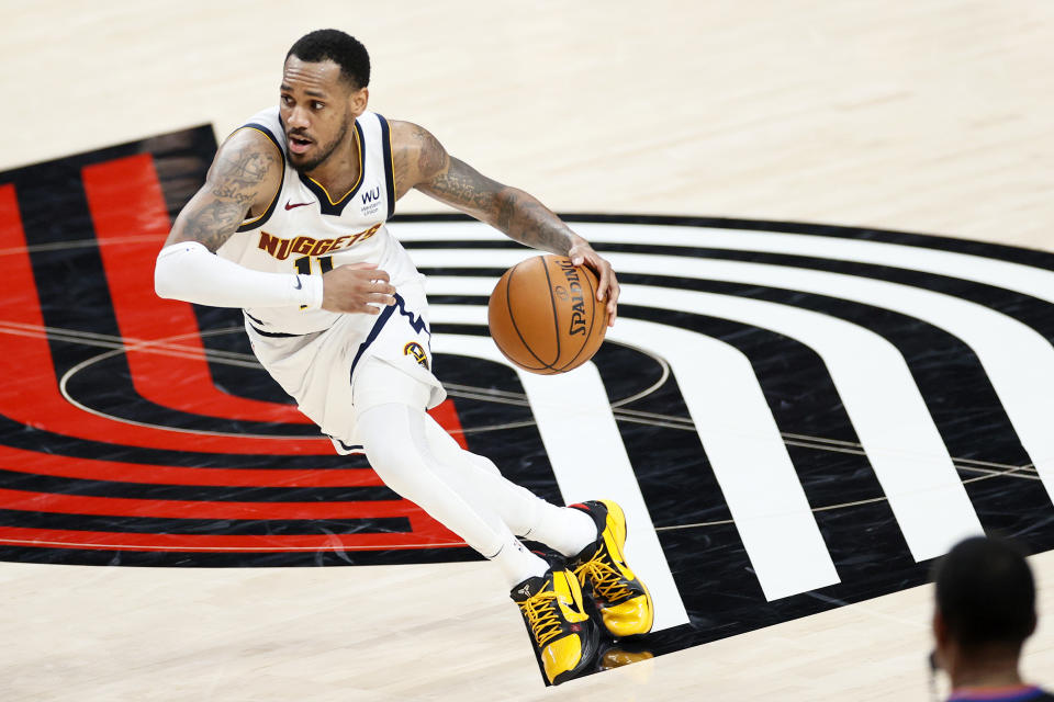 Monte Morris #11 of the Denver Nuggets dribbles in the fourth quarter against the Portland Trail Blazers during Round 1, Game 6 of the 2021 NBA Playoffs at Moda Center on June 03, 2021 in Portland, Oregon. NOTE TO USER: User expressly acknowledges and agrees that, by downloading and or using this photograph, User is consenting to the terms and conditions of the Getty Images License Agreement. (Photo by Steph Chambers/Getty Images)