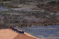 <p>A house next to a mangrove swamp affected by a local construction in Cancun, August 12, 2015. <i>(Photo: Reuters/Edgard Garrido)</i></p>