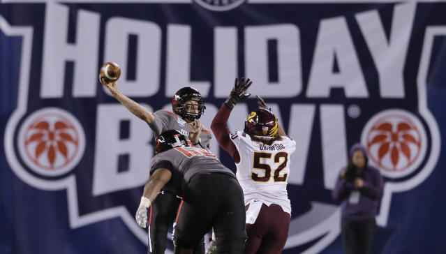 Texas Tech quarterback Davis Webb, left, throws a pass under pressure from Arizona State linebacker Carl Bradford, right, in the second half during the Holiday Bowl NCAA college football game Monday, Dec. 30, 2013, in San Diego. (AP Photo/Gregory Bull)
