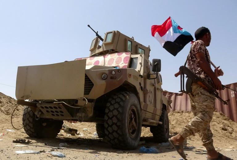 A fighter loyal to Yemen's Southern Transitional Council holds the separatist flag amid clashes with pro-government troops in Abyan province in the weeks after the STC declared autonomy in southern Yemen on April 26 (AFP Photo/Nabil HASAN)