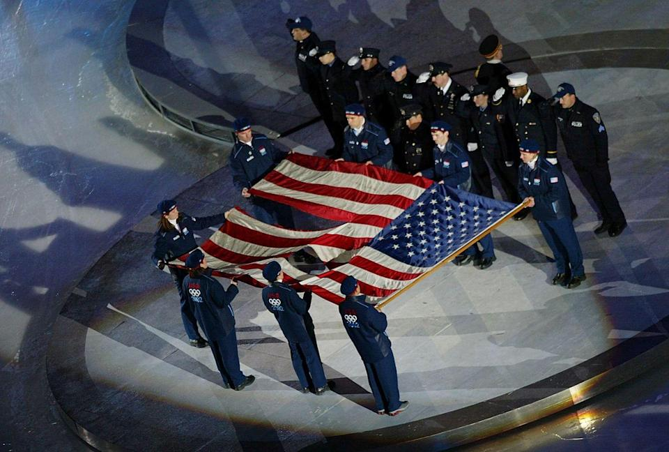 """<p>As the United States hosted the 2002 Winter Olympics, the country paid respect to victims of the 9/11 terrorist attacks during the opening ceremony. During the national anthem, the stadium saluted an <a href=""""https://olympics.com/ioc/news/ground-zero-flag-to-fly-during-olympic-winter-games/"""" rel=""""nofollow noopener"""" target=""""_blank"""" data-ylk=""""slk:American flag found at Ground Zero"""" class=""""link rapid-noclick-resp"""">American flag found at Ground Zero</a>. </p>"""