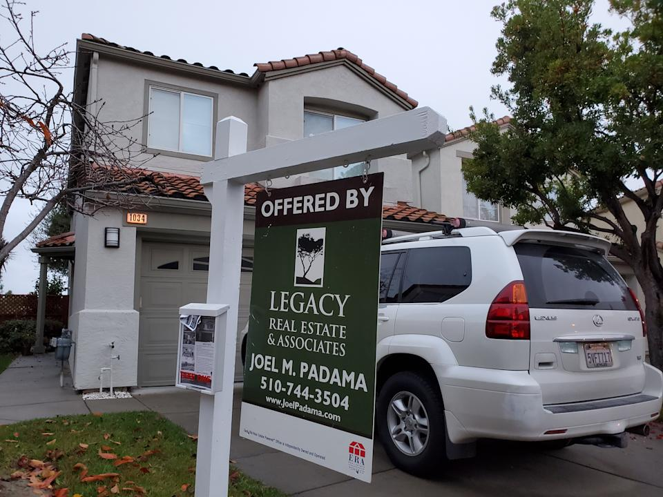 Sign on home for sale from realtor Legacy Real Estate Associates in the San Francisco Bay Area, San Ramon, California, December 12, 2019. Home prices in the Bay Area are among the highest in the country, with homes like the one depicted selling for over $1m. (Photo by Smith Collection/Gado/Getty Images)
