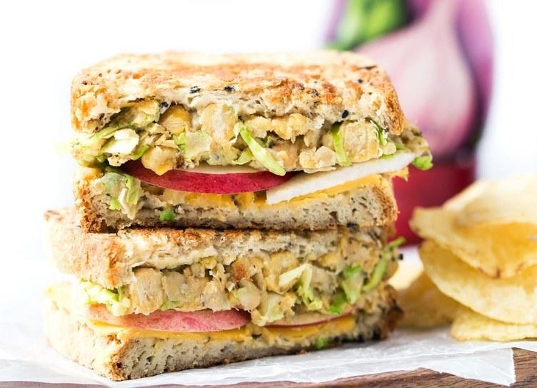 """<p>This grilled-cheese sandwich tastes good hot or cold, thanks to a chickpea-Brussels sprouts filling that's equal parts creamy and crunchy. Get the recipe <a rel=""""nofollow"""" href=""""https://www.simplyquinoa.com/brussels-sprout-hummus-grilled-cheese-sandwich?mbid=synd_yahoofood"""">here</a>.</p><p><b>Per one serving:</b> <em>530 calories, 20 grams protein</em></p>"""
