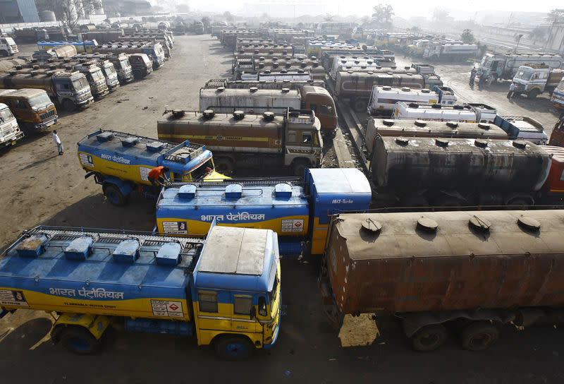 Oil tankers are seen parked at a yard outside a fuel depot on the outskirts of Kolkata