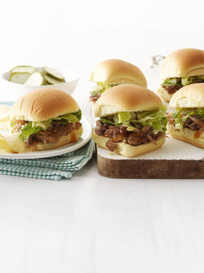 """<p>Orange marmalade and cider vinegar give these pint-sized pork sliders a deliciously satiating sweet-and-sour kick.</p><p><a href=""""https://www.womansday.com/food-recipes/food-drinks/recipes/a12213/pulled-pork-sliders-romaine-slaw-recipe-wdy0313/"""" rel=""""nofollow noopener"""" target=""""_blank"""" data-ylk=""""slk:Get the recipe for Pulled Pork Sliders with Romaine Slaw."""" class=""""link rapid-noclick-resp""""><em><strong>Get the recipe for Pulled Pork Sliders with Romaine Slaw.</strong></em></a></p>"""
