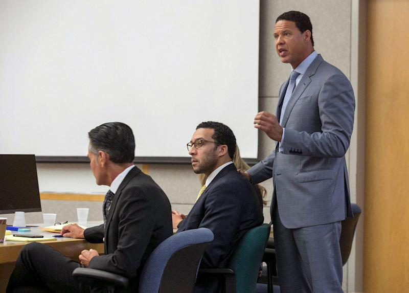 Brian Watkins, right, an attorney for former NFL football player Kellen Winslow II, puts his hands on Winslow as he gives his opening statement to the jury during Winslow's rape trial. (AP)