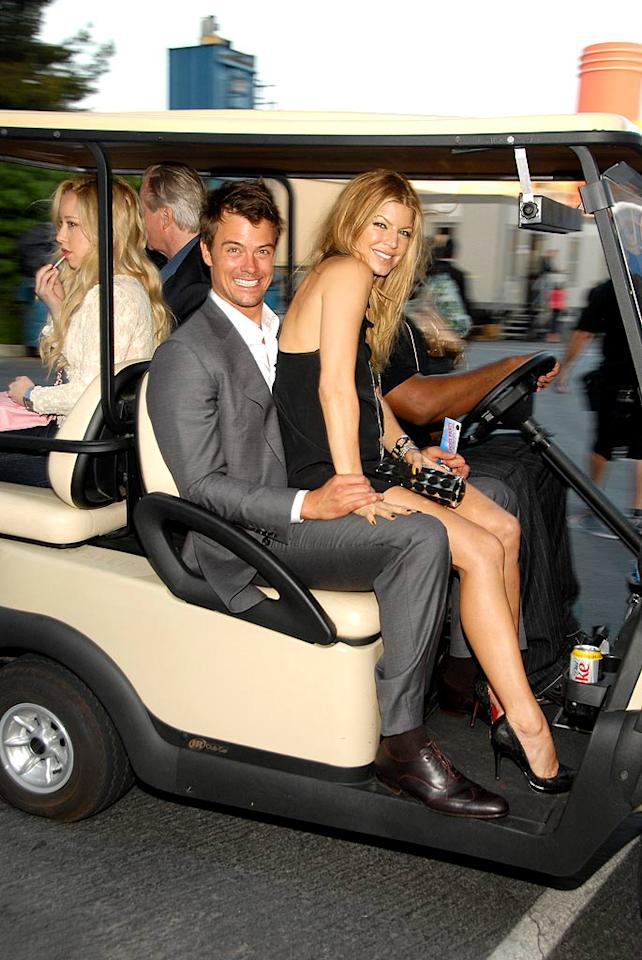 "Fergie gets a ride from her honey Josh Duhamel. Kevin Mazur/<a href=""http://www.wireimage.com"" target=""new"">WireImage.com</a> - June 3, 2007"