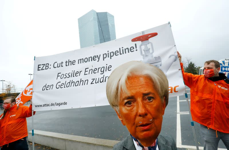 FILE PHOTO: Activists protest against the European Central Bank's fossil fuel bond buying, Frankfurt, Germany