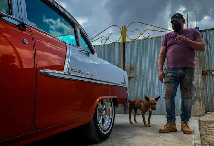 Self-taught Cuban auto body mechanic Pablo Manso repairs Chevrolets from 1955, 1956 and 1957