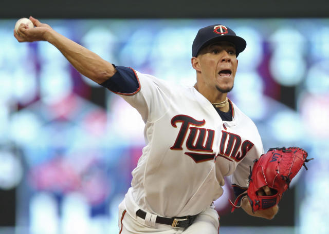 Minnesota Twins pitcher Jose Berrios throws to a Boston Red Sox batter during the fourth inning of a baseball game Tuesday, June 19, 2018, in Minneapolis. (AP Photo/Jim Mone)