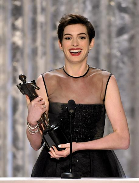 "Anne Hathaway accepts the award for outstanding female actor in a supporting role for ""Les Miserables"" at the 19th Annual Screen Actors Guild Awards at the Shrine Auditorium in Los Angeles on Sunday, Jan. 27, 2013. (Photo by John Shearer/Invision/AP)"