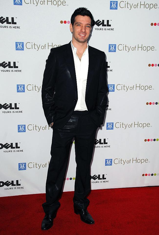 "Former 'N Sync member JC Chasez popped a pose in an open-collared shirt and beautiful black blazer. Jordan Strauss/<a href=""http://www.wireimage.com"" target=""new"">WireImage.com</a> - October 15, 2008"