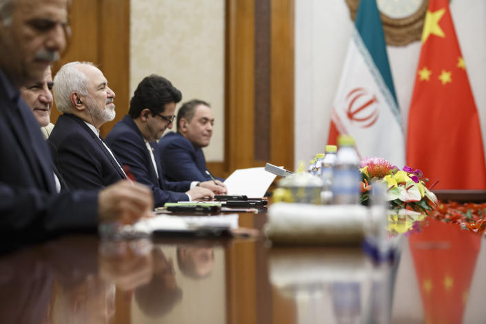 Iranian Foreign Minister Mohammad Javad Zarif, third left, meets Chinese Foreign Minister Wang Yi (not pictured) at the Diaoyutai State Guesthouse in Beijing, Friday, May 17, 2019. (Thomas Peter/Pool Photo via AP)
