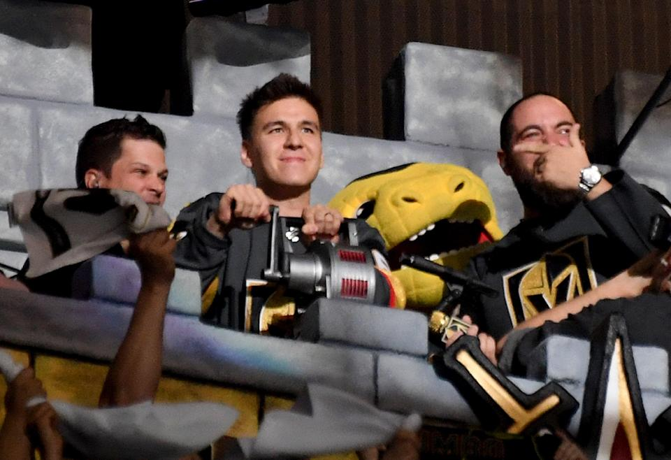 """LAS VEGAS, NEVADA - APRIL 21:  Professional sports gambler and """"Jeopardy!"""" champion James Holzhauer of Nevada sounds a siren in the Castle before the start of Game Six of the Western Conference First Round between the San Jose Sharks and the Vegas Golden Knights during the 2019 NHL Stanley Cup Playoffs at T-Mobile Arena on April 21, 2019 in Las Vegas, Nevada. The Sharks defeated the Golden Knights 2-1 in double overtime to even the series at 3-3.  (Photo by Ethan Miller/Getty Images)"""