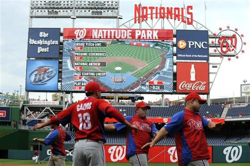 "A ""Natitude Park"" banner covers part of the scoreboard prior to a baseball game between the Philadelphia Phillies and Washington Nationals at Nationals Park, Friday, May 4, 2012, in Washington. (AP Photo/Richard Lipski)"