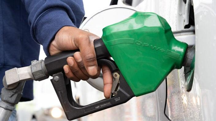 A man refuels at a gas station on May 12, 2021 in Fayetteville, North Carolina. Most stations in the area along I-95 are without fuel following the Colonial Pipeline hack. (Photo by Sean Rayford/Getty Images)