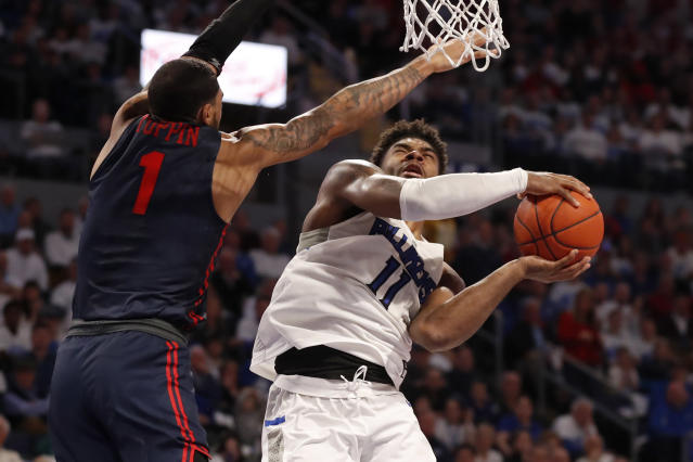 Saint Louis' Hasahn French (11) heads to the basket as Dayton's Obi Toppin (1) defends during the second half of an NCAA college basketball game Friday, Jan. 17, 2020, in St. Louis. Dayton won 78-76 in overtime. (AP Photo/Jeff Roberson)