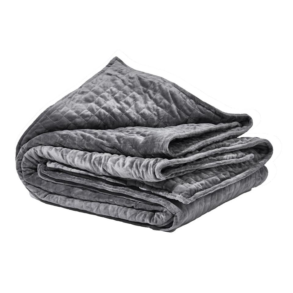 """Even the most dedicated grouch on your gift list will appreciate this weighted blanket that simulates the feeling of a warm hug. Backed by """"deep touch pressure stimulation,"""" it can help him drift off into sleep with less stress. $249, Gravity. <a href=""""https://gravityblankets.com/collections/blankets-duvet-covers/products/gravity-blanket?variant=44868533007"""">Get it now!</a>"""
