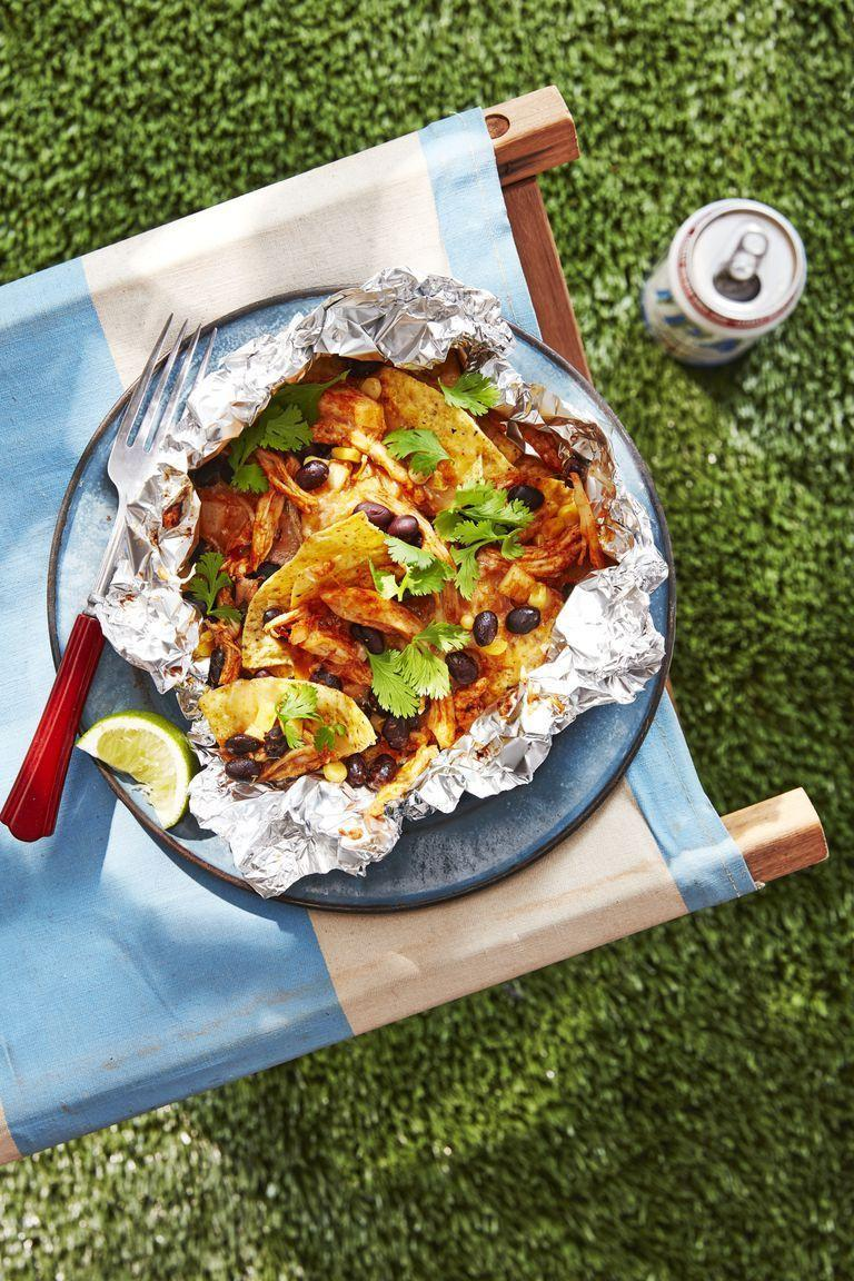 "<p>Fire up the grill to make this <a href=""https://www.countryliving.com/food-drinks/g3394/foil-pack-recipes/"" rel=""nofollow noopener"" target=""_blank"" data-ylk=""slk:foil pack recipe"" class=""link rapid-noclick-resp"">foil pack recipe</a>. Not only can you eat it just about anywhere, but there's also no dish-washing needed for this dinner. Now that's a winner!</p><p><strong><a href=""https://www.countryliving.com/food-drinks/a28071322/chicken-and-black-bean-nachos-recipe/"" rel=""nofollow noopener"" target=""_blank"" data-ylk=""slk:Get the recipe."" class=""link rapid-noclick-resp"">Get the recipe.</a></strong></p><p><strong><a class=""link rapid-noclick-resp"" href=""https://go.redirectingat.com?id=74968X1596630&url=https%3A%2F%2Fwww.walmart.com%2Fip%2FExpert-Grill-3-Burner-30-000-BTU-Gas-Grill-with-Side-Shelves-Black%2F736502457&sref=https%3A%2F%2Fwww.countryliving.com%2Ffood-drinks%2Fg680%2Fchicken-recipes-0109%2F"" rel=""nofollow noopener"" target=""_blank"" data-ylk=""slk:SHOP GRILLS"">SHOP GRILLS</a><br></strong></p>"