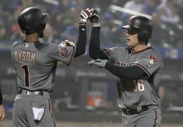 Arizona Diamondbacks' John Ryan Murphy (36) celebrates with teammate Jarrod Dyson (1) after hitting a two-run home run against the New York Mets during the fourth inning of a baseball game, Saturday, May 19, 2018, in New York. (AP Photo/Julie Jacobson)