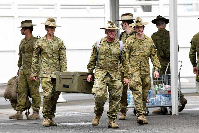 Australian Defence Force (ADF) personal wait for returning overseas travellers at Sydney International Airport in Sydney.