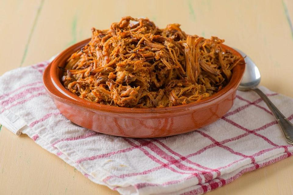 """This recipe yields fall-off-the-bone tender smoked pork shoulder. We recommend piling it high on a hamburger bun, dousing it with a vinegar sauce, and topping it off with a <a href=""""https://www.epicurious.com/recipes/food/views/classic-coleslaw-51235880?mbid=synd_yahoo_rss"""" rel=""""nofollow noopener"""" target=""""_blank"""" data-ylk=""""slk:fresh coleslaw"""" class=""""link rapid-noclick-resp"""">fresh coleslaw</a>. <a href=""""https://www.epicurious.com/recipes/food/views/north-carolina-pulled-pork-242247?mbid=synd_yahoo_rss"""" rel=""""nofollow noopener"""" target=""""_blank"""" data-ylk=""""slk:See recipe."""" class=""""link rapid-noclick-resp"""">See recipe.</a>"""