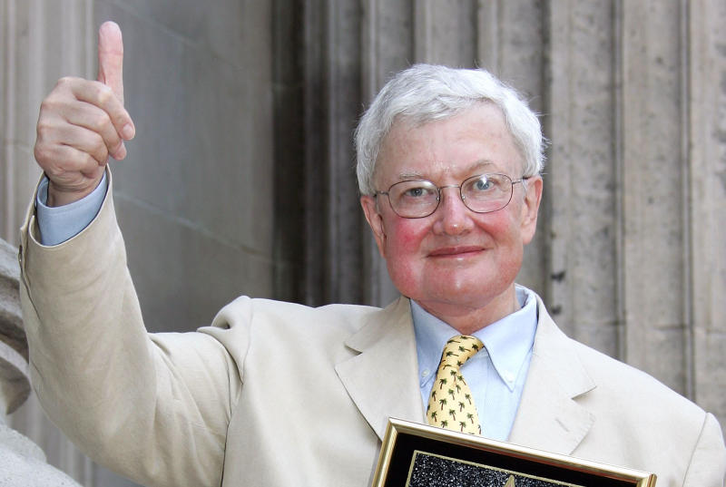 Roger Ebert gestures as he receives the 2,288th star on the Hollywood Walk of Fame on June 23, 2005. (Photo by Frazer Harrison/Getty Images)