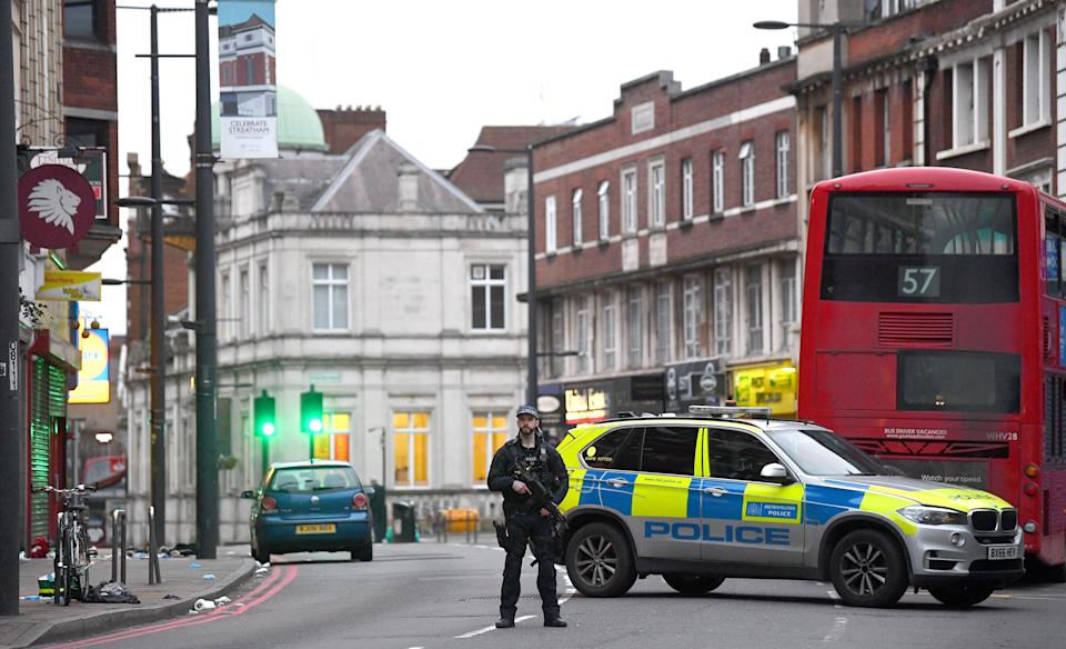 Armed police at the scene in Streatham High Road, south London, after a man was shot dead by armed officers (Victoria Jones/PA) (PA Archive)