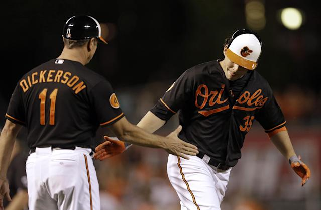Baltimore Orioles designated hitter Danny Valencia, right, is greeted by third base coach Bobby Dickerson as he rounds the bases after hitting a solo home run in the third inning of a baseball game against the Chicago White Sox, Friday, Sept. 6, 2013, in Baltimore. (AP Photo/Patrick Semansky)