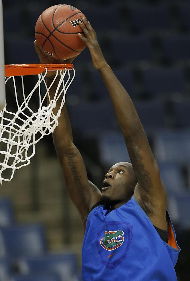 Florida forward Dorian Finney-Smith works out during practice at the NCAA college basketball tournament, Wednesday, March 26, 2014, in Memphis, Tenn. Florida plays UCLA in a regional semifinal on Thursday. (AP Photo/John Bazemore)